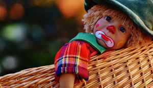 sad child-clown in basket