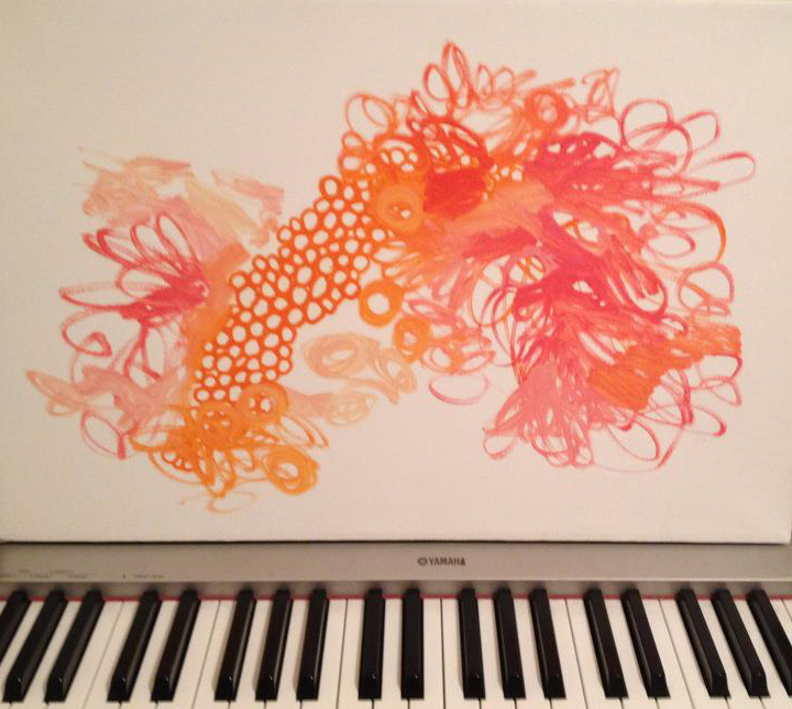 Painting of choral circles/swirls, sitting on piano keyboard: 2 art-forms interacting